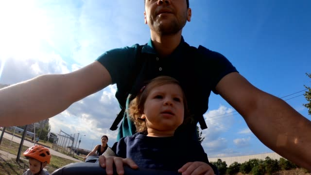 father riding bicycle with his daughter - bicycle seat stock videos & royalty-free footage