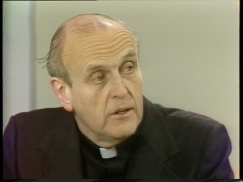 father robert drinan, us representative from ma, predicts that jimmy carter will get 65 to 70% of the catholic vote in the presidential election. - 1976年点の映像素材/bロール