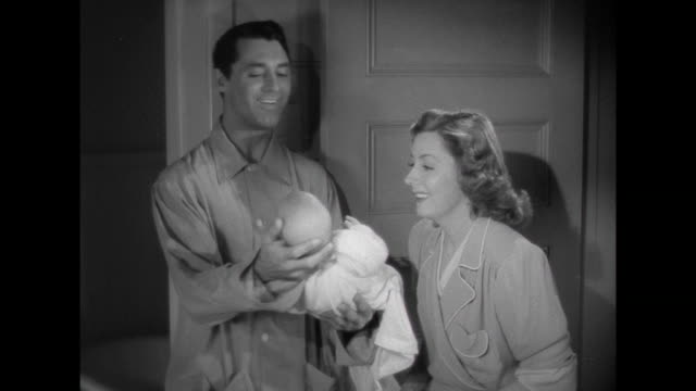 stockvideo's en b-roll-footage met 1941 father (cary grant) seems to have found the trick to quieting infant - stille