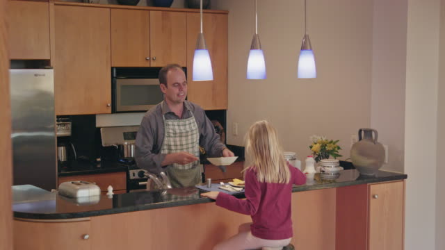 Father Serves Dinner Young Daughter