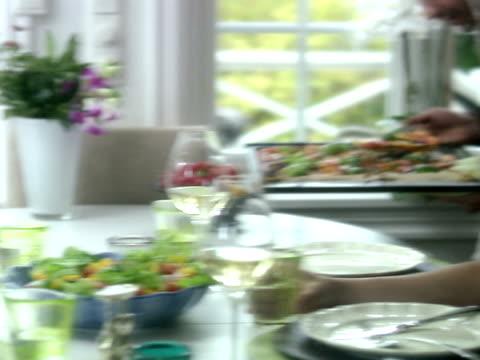 Father serving dinner Sweden.