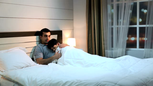 father sleeping with his son, delhi, india - black hair stock videos & royalty-free footage