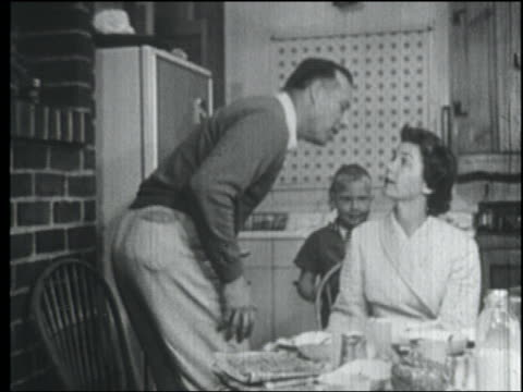 b/w 1958 father + son kiss housewife in bathrobe goodbye as they leave in morning - 1958 stock videos & royalty-free footage