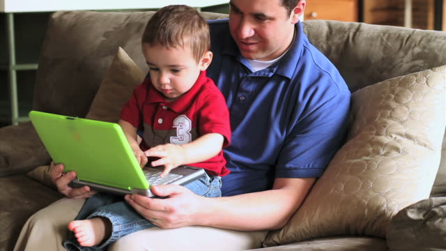 father son with laptop - genderblend stock videos & royalty-free footage