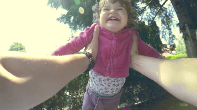 father swinging daughter around by her arms - swinging stock videos & royalty-free footage