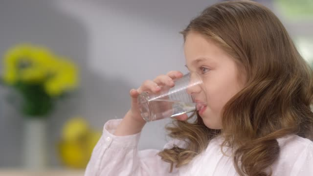 father taking care of daughter. child drinking water - purified water stock videos & royalty-free footage