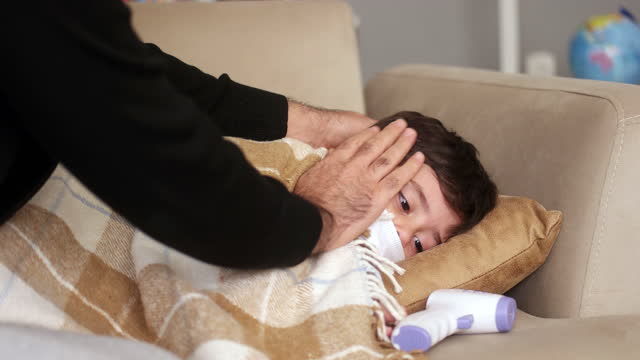 father taking temperature - illness stock videos & royalty-free footage