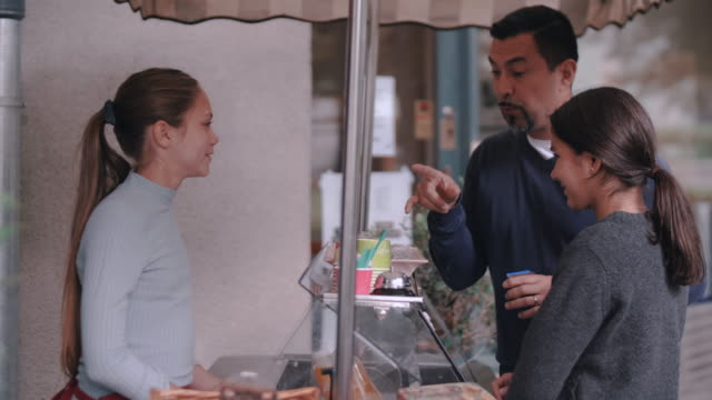 father talking with owner while buying ice cream for daughter - selling stock videos & royalty-free footage