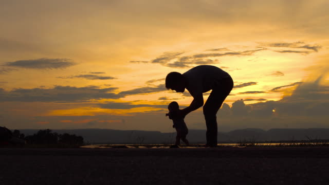 father teaching a baby to walk - single father stock videos & royalty-free footage