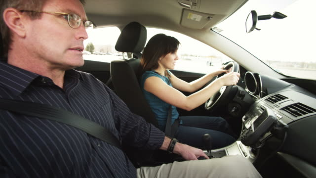 stockvideo's en b-roll-footage met ms father teaching daughter to drive / provo, utah, usa - oefenen