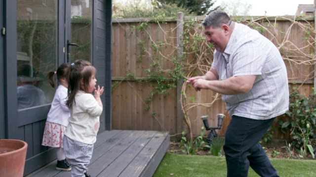 a father teaching his 2 young daughters to use sign language - sign language stock videos & royalty-free footage