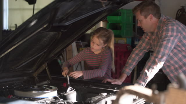 MS Father teaching his daughter about cars