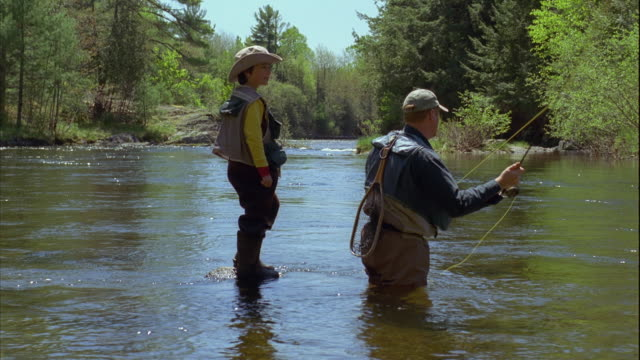 ms pan father teaching son (8-9) fly fishing on grand lake stream / maine, usa - maine stock videos & royalty-free footage