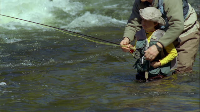 ms tu father teaching son (8-9) fly fishing on grand lake stream / maine, usa - maine stock videos & royalty-free footage