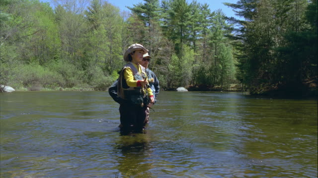 ws tu father teaching son (8-9) fly fishing, standing in river / maine, usa - fly fishing stock videos and b-roll footage