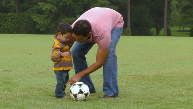 ZO, MS, Father teaching son (18-23 months) playing soccer, Richmond, Virginia, USA