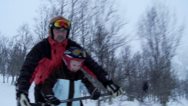 MS, Father teaching son (6-7) to ski, Hemsedal, Norway