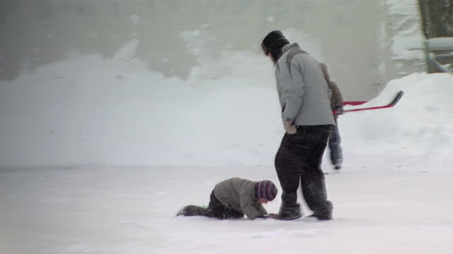 MS TS Father teaching young child how to skate / Khimki, Moscow Suburb, Russia