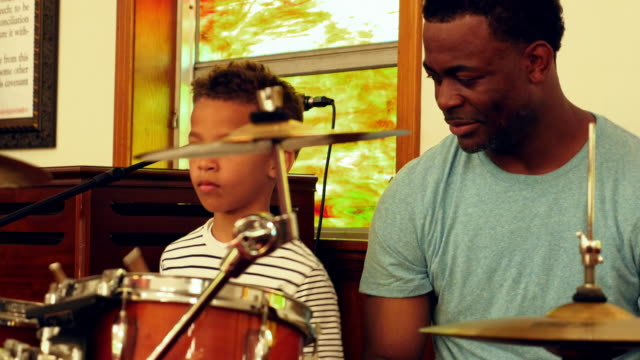 MS Father teaching young son to play drums