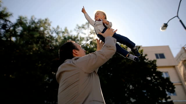 father throwing son into air after work.happiness,together - throwing stock videos & royalty-free footage