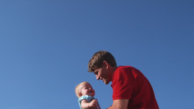 slo mo ms father tossing daughter (6-11 months) up in air / utah, usa - throwing stock videos & royalty-free footage
