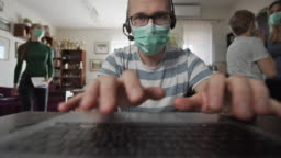 Father trying to work from home during COVID-19 pandemic