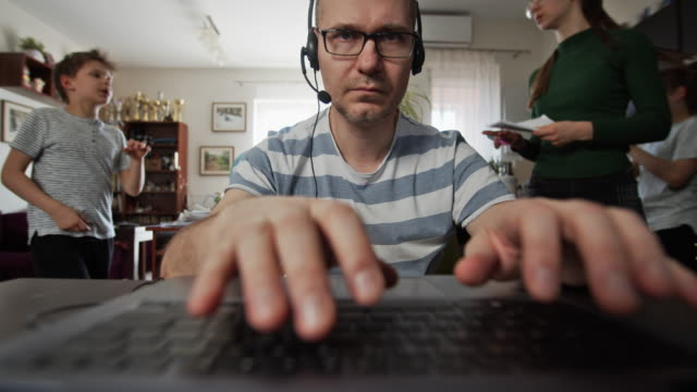 father trying to work from home - moving image stock videos & royalty-free footage