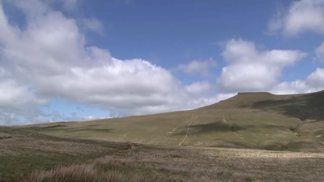 father visits brecon beacons where his son died on an sas training march wales brecon beacons ext gv open hillside with clouds scudding across david... - ブレコンビーコンズ国立公園点の映像素材/bロール