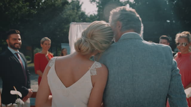 father walking with bride towards bridegroom - daughter stock videos & royalty-free footage