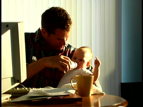father with baby - genderblend video stock e b–roll