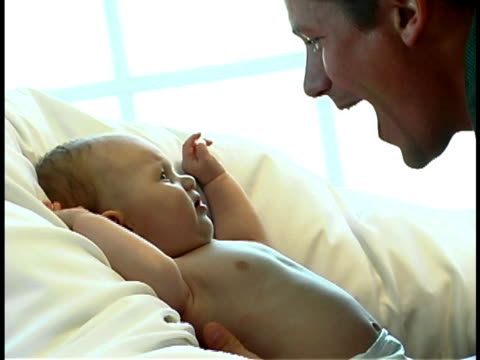 father with baby - unknown gender stock videos & royalty-free footage
