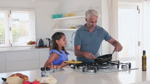 father with daughter in kitchen - modern manhood stock videos & royalty-free footage