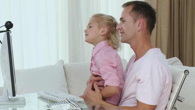 ms father with daughter (8-9) looking at computer at home / cape town, south africa - see other clips from this shoot 1811 stock videos & royalty-free footage