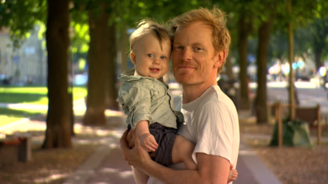 stockvideo's en b-roll-footage met father with happy baby son. - genderblend