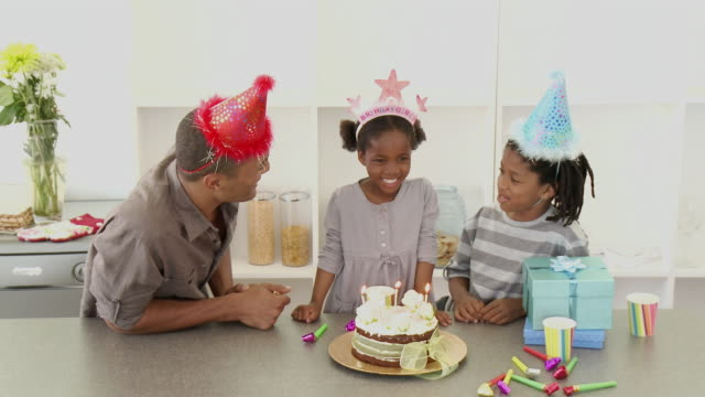 MS Father with son (8-9) and daughter (4-5) celebrating birthday / Cape Town, Western Cape, South Africa