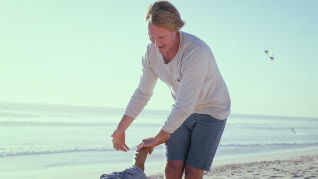Father with son on beach