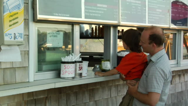 td, pan, father with son (6-7) ordering food at window, wellfleet, massachusetts, usa - balding stock videos & royalty-free footage