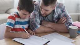 Father with son studying at home
