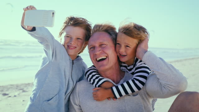 father with sons taking selfie - part of a series stock videos & royalty-free footage