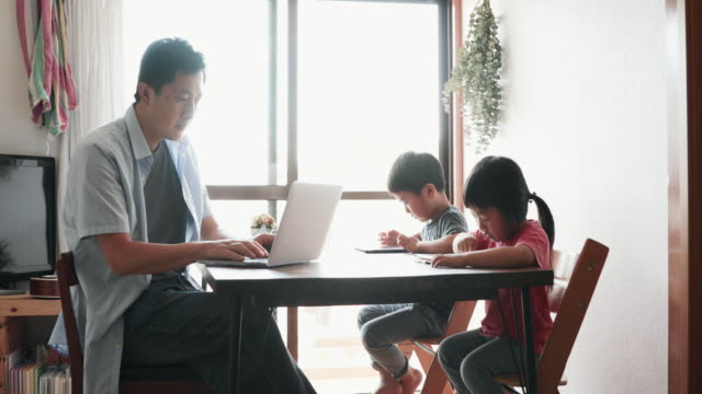 father working at home with children - telecommuting stock videos & royalty-free footage