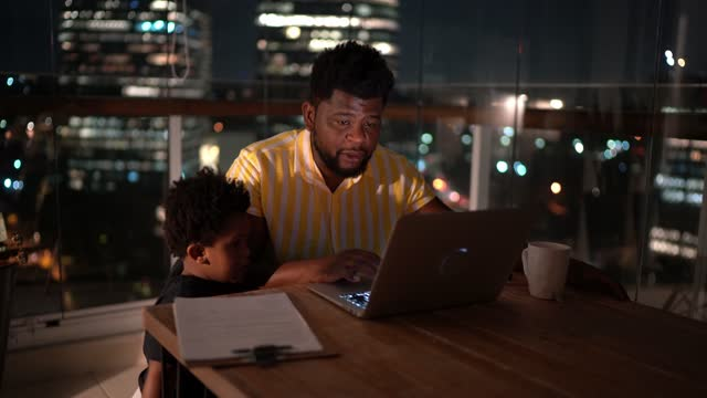 father working at home with son - leaf stock videos & royalty-free footage