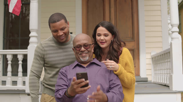 father-in-law takes selfies with his son and wife who are new homeowners - wilmington north carolina stock videos & royalty-free footage