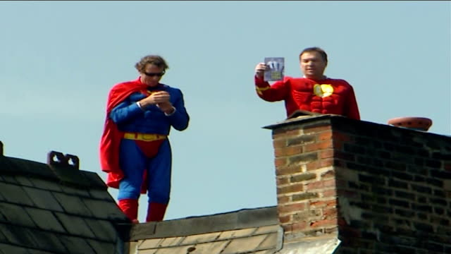 fathers 4 justice protesters climb on to roof of harriet harman's house england london herne hill ext protesters on rooftop of house of deputy labour... - herne hill stock videos & royalty-free footage