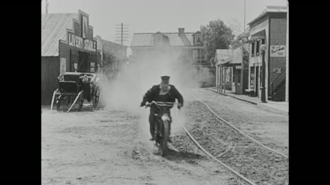 fatty arbuckle, buster keaton, and their supervisor chase a group of bank robbers and the group of men jump onto a horse trolley and take off, leaving the three in their dust - 1910 1919 stock videos & royalty-free footage