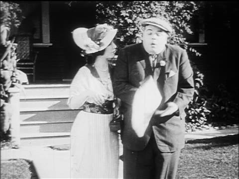 b/w 1914 fatty arbuckle + mabel normand gasping as they look at newspaper - 1914 stock videos & royalty-free footage