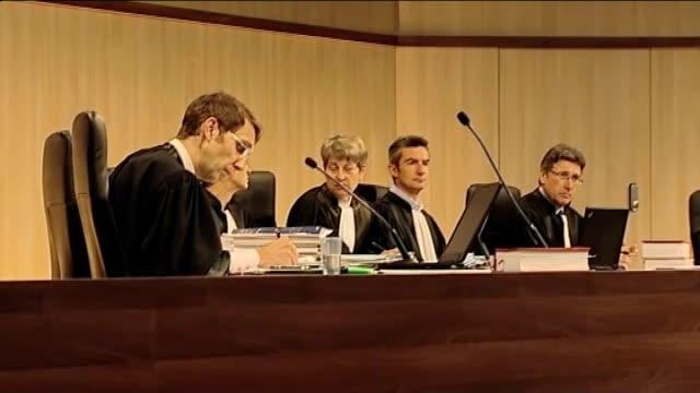 british victim gives evidence judges seated at jeanclaude mas trial jeanclaude mas taking seat at trial - breast implant stock videos and b-roll footage