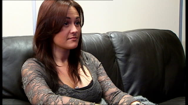 government review recommends no routine removal of implants Emma Turton setup seated on sofa and interview SOT