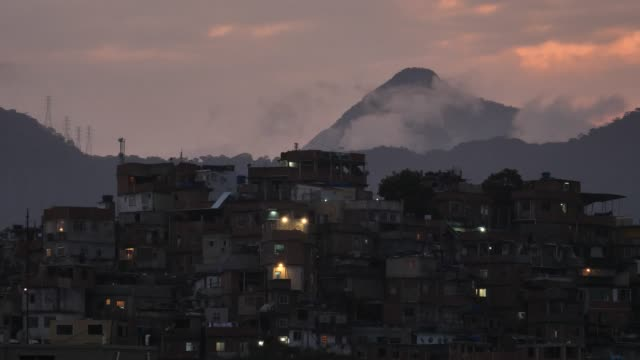 favela evening with red sky - slum stock videos & royalty-free footage