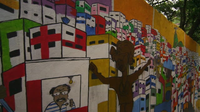 vídeos y material grabado en eventos de stock de favela graffiti on wall next to flight of stairs - brasil