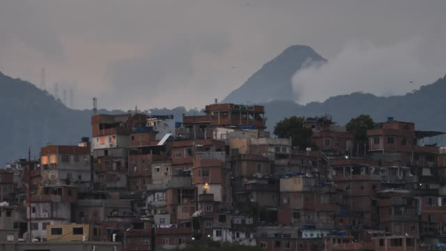 vídeos de stock e filmes b-roll de favela with moving clouds - parte mediana